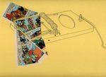 disegno di una trappola per topi con incastrati dei fumetti di topolino
