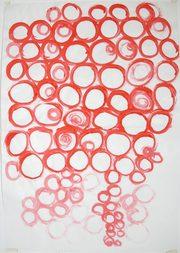 disegno su carta con cerchi concentrici di colore giallo e arancione